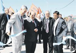 Julio De Vido, Juan José Mussi, José López y Juan Patricio Mussi durante la inauguración del edificio de la Escuela Secundaria N° 11 del Barrio Villa Olivero.